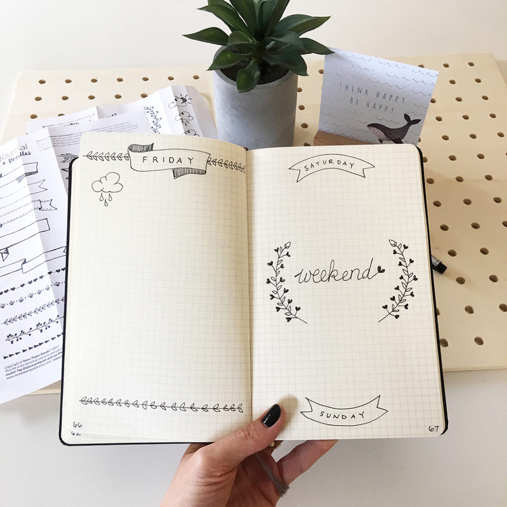 Bullet journal pages with hand drawn decorations and lettering